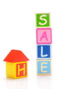 Home sale wooden block of and letters on white background Stock Photos