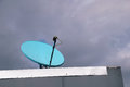 Home sattelite dish on roof. Royalty Free Stock Photo