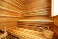 Home sauna interior small wooden with tub two level bench Royalty Free Stock Photos
