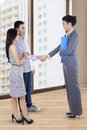 Home selling transaction portrait of asian people in Stock Image