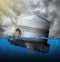 Home sinking in water a house is for a mortgage debt or natural disaster concept Stock Photography