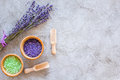 Home spa with lavender herbs cosmetic salt for bath on stone desk background top view mock-up Royalty Free Stock Photo