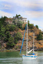 Home steep cliff sailboat view a beautiful house with lots of windows standing just steps from the edge of a with an anchored in Royalty Free Stock Photography