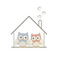Home sweet home cute owls couple in their cozy nest Royalty Free Stock Photography