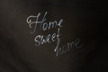 Home Sweet Home inscription on black background