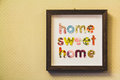 Home sweet home sign hung on a wall Royalty Free Stock Photo