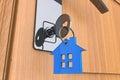 Home-Taste mit Haus keychain Symbol Lizenzfreie Stockfotografie