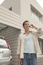 Home Tech Man with Cell Phone and Car Royalty Free Stock Photo