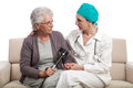Home visit doctor comforting old disabled woman a female is an and patient talking about recovery process isolated on white Stock Photography
