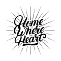 Home is where the heart is hand written lettering.