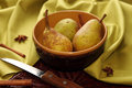 Homegrown pears from rural garden in ceramic bowl on napkin and cinnamon sticks and stars aniseed tree on cloth gorizontal image Stock Image