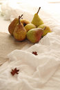 Homegrown pears from rural garden on peace of linen fabric and gauze vertical image Stock Image