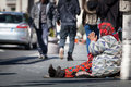 Homeless beggar. Woman asking for alms. Street. Rome Italy