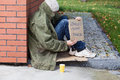Homeless begging for money poor on a street Royalty Free Stock Images
