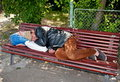Homeless on the bench Royalty Free Stock Photo