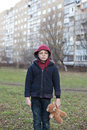 Homeless boy with bear young Stock Images
