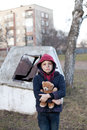 Homeless boy with bear young Royalty Free Stock Photography