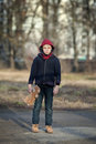 Homeless boy with bear young Stock Photography