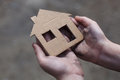 Homeless boy holding a cardboard house Royalty Free Stock Photo