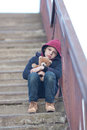 Homeless boy sitting on the bridge young Stock Photo