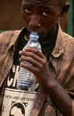 A homeless boy sniffing glue in Kampala, Uganda Royalty Free Stock Image
