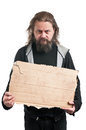 Homeless man holding cardboard sign a a isolated on white Royalty Free Stock Photos