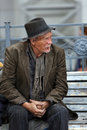 Homeless man lonely old sitting on a bench on the street Royalty Free Stock Photos