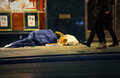 Homeless man sleeping on the street sweden Royalty Free Stock Photo