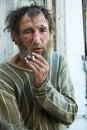 Homeless man smoking cigarette Royalty Free Stock Photo