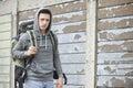 Homeless teenage boy on street with rucksack teenager Stock Image