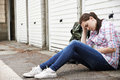 Homeless teenage girl on streets with rucksack Stock Photos