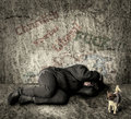 Homeless woman with dog Royalty Free Stock Image