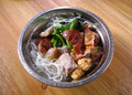 Homely dish filipino with baked duck taro salted pork vegetable Stock Photo
