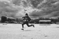 image photo : Business man runing in the beach. Motion blur