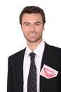 Homem de negócios de sorriso com uma foto Fotografia de Stock Royalty Free