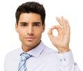 Homem de negócios seguro gesturing okay sign Fotos de Stock