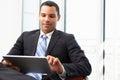 Homem de negócios using digital tablet no escritório Fotografia de Stock