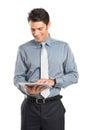 Homem de negócios using digital tablet Fotografia de Stock Royalty Free