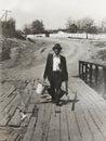 Homem idoso da foto do vintage com uma vara de pesca Imagem de Stock Royalty Free