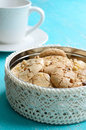 Homemade almond cookies wih walnuts in the box on blue background Stock Images