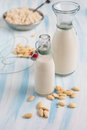 Homemade almond milk bottle of in a small jar Royalty Free Stock Photo