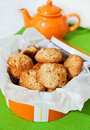 Homemade apple cookies in the box orange with teapot on background Stock Images