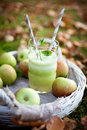 Homemade applejuice green juice made from fresh apples Stock Images