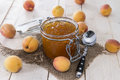 Homemade apricot jam on wooden background Stock Images