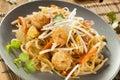 Homemade asian pad thai with shrimp and cilantro Stock Photo