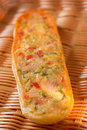 Homemade baguette with great cheese filling on a beautiful background Royalty Free Stock Photos