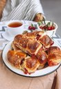 Homemade baked croissant with fresh garden cherries
