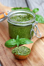 Homemade basil pesto jar of Stock Photo