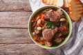 Homemade beef bourguignon in a bowl horizontal top view on the table from above Royalty Free Stock Image