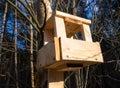 Homemade bird feeders made of wooden bars